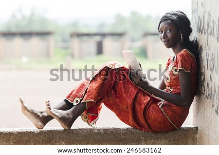 Business Person Working In School for Lesson (African Student Typing) - stock photo