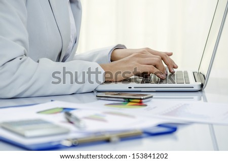 Business person working on her PC - stock photo
