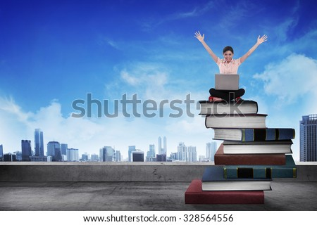 Business person working with laptop on  the top of books. Career and education concept - stock photo