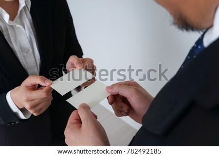 Business persons exchanging business cards stock photo royalty free business persons exchanging business cards colourmoves