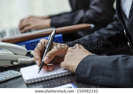 Business persons working on the desk in office - stock photo