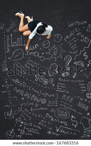 business plan concept: woman writing plan of project on a floor - stock photo