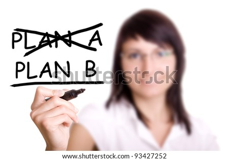 Business plan strategy changing. Woman crossing over Plan A, writing Plan B. - stock photo