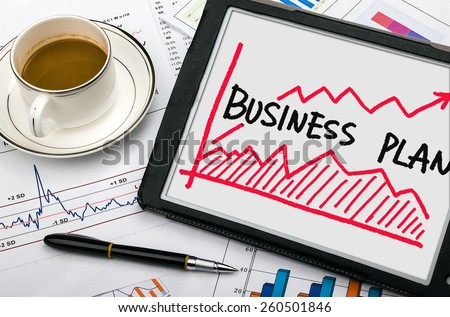 business plan with financial chart hand-drawn on tablet pc - stock photo