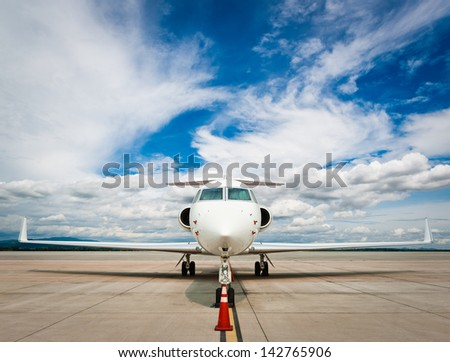 Business plane at airport - stock photo