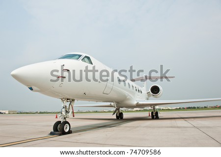 business plane parked at the airport