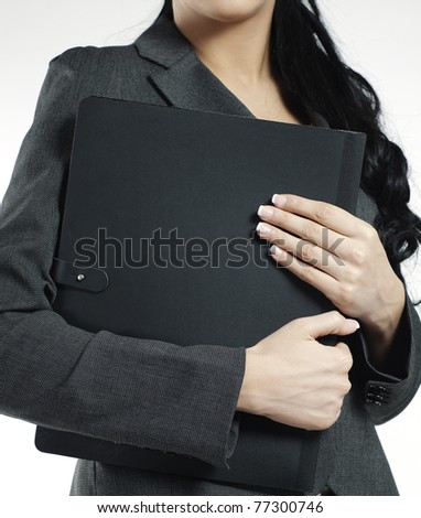 business portfolio held by a woman - stock photo