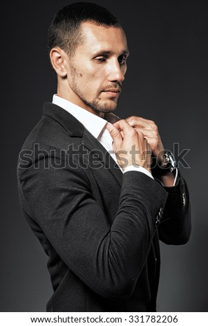 Business portrait of a handsome fashionable man in coat - stock photo