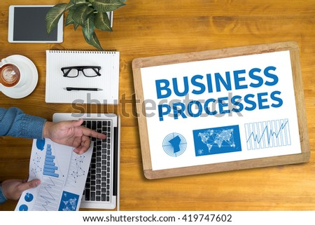 BUSINESS PROCESSES Businessman working at office desk and using computer and objects, coffee, top view, - stock photo