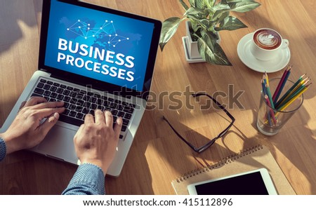 BUSINESS PROCESSES man hand on table Business, coffee, Split tone - stock photo