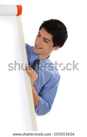 Business professional looking at a flip chart - stock photo