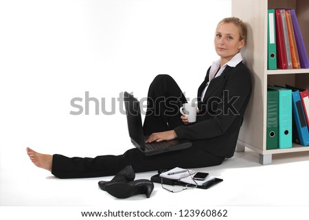Business professional taking it easy - stock photo