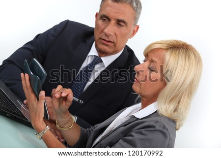 Business professionals calculating costs - stock photo