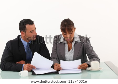 Business professionals reviewing reports - stock photo