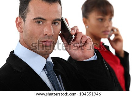 Business professionals talking on their mobile phones - stock photo