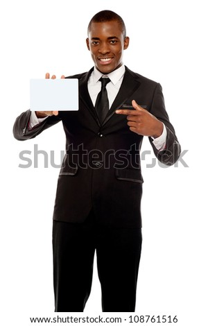 Business promoter pointing at blank placard looking right into camera - stock photo