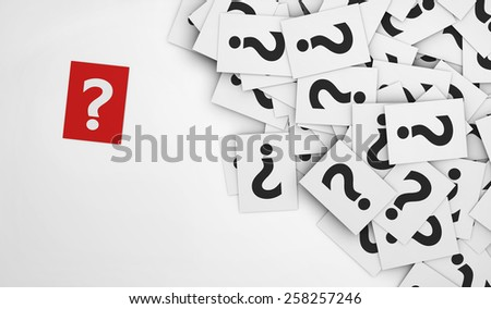 Business questions concept with a question mark symbol on a red paper and a multitude of question marks signs on scattered white papers. - stock photo