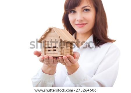 business, real estate and banking concept - smiling businesswoman with house, close-up - stock photo