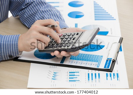 business report and man hand with pen. Accounting