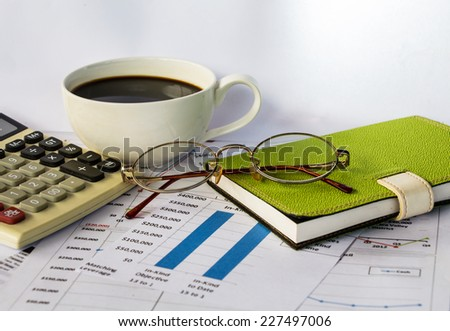Business report with cup of coffee - stock photo