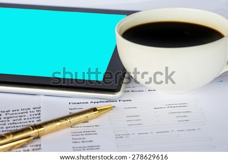 Business report with cup of coffee and tablet