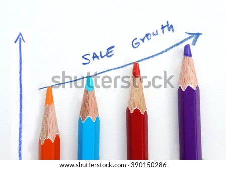 Business sale graph made by pencils on white background. - stock photo