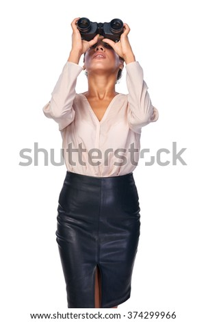 Business search concept. Business woman looking through binoculars upwards, isolated over white