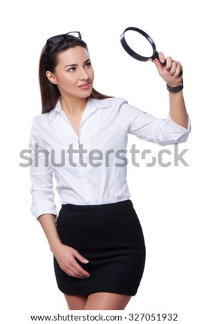Business search concept. Smiling business woman looking through magnifying glass at blank copy space, isolated over white - stock photo