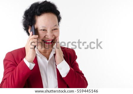 Business Senior woman talking cellphone over white background