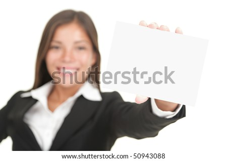 Business sign. Beautiful smiling woman holding big business card / blank empty sign. Isolated on white background, focus on hand and card. - stock photo
