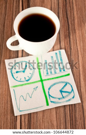 Business sign on a napkin and cup of coffee - stock photo