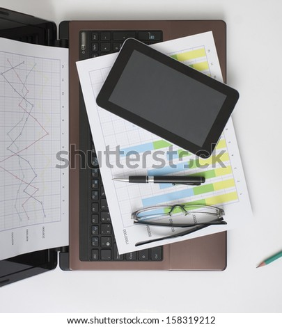 Business Situation in the Office on White Table - stock photo