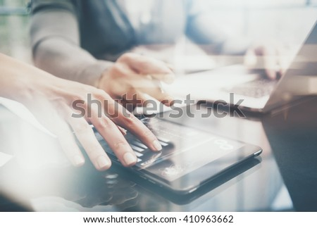 Business situation.Meeting of financial managers.Photo female showing document.Man holding report, using laptop.Working process modern office,discussion startup. Horizontal. Film and bokeh effects - stock photo