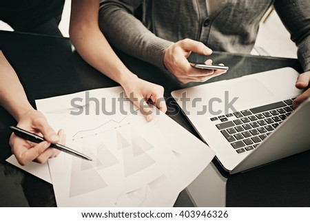 Business situation, team work. Closeup photo finance manager working modern office with new business project. Using laptop,smartphone, startup idea. Horizontal. Blurred background,film effect