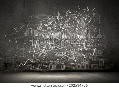 Business sketches and drawings on black wall - stock photo