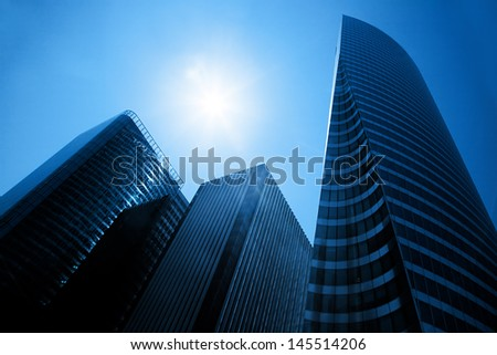 Business skyscrapers, sunny blue sky. La Defense financial district in Paris, France. - stock photo