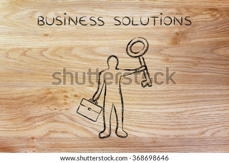 business solutions: business man holding giant key - stock photo