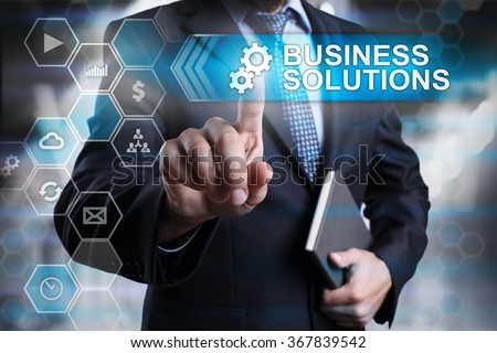 Business solutions concept. Businessman pointing on virtual screen with text and icons. - stock photo