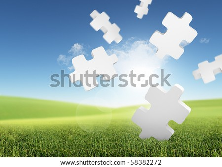 Business Solutions. Conceptual image with falling puzzle pieces in a green field. - stock photo