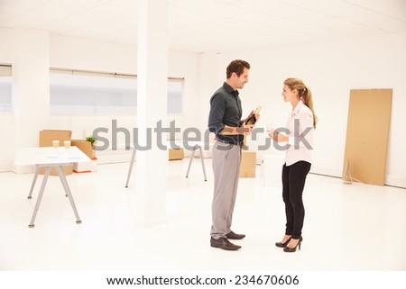 Business Start Up Celebrating Move Into New Office - stock photo