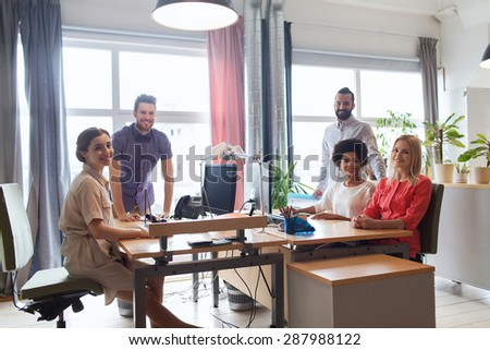 business, startup and people concept - happy creative team in office - stock photo
