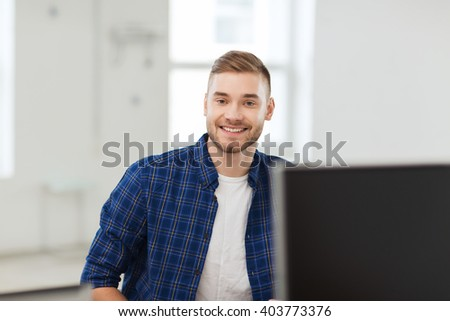business, startup, education and people concept - happy creative man or student at office - stock photo