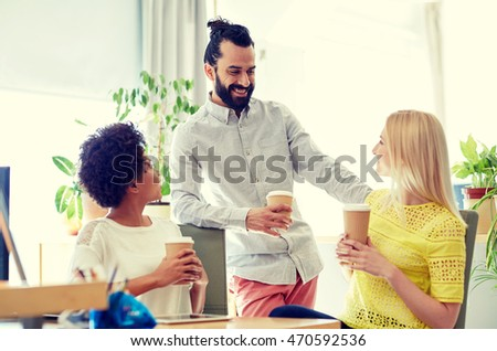 business, startup, people and teamwork concept - happy creative team drinking coffee in office