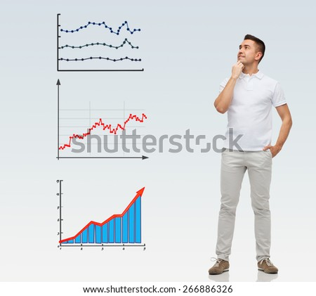 business, statistics, economics and people concept - smiling man with hands in pockets looking up to growing chart over gray background - stock photo