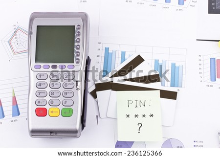 Business still-life of a payment terminal, cards, sticker - stock photo