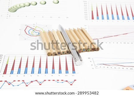 Business still-life of pen, pencil, charts, tables - stock photo