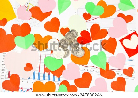 Business still-life of the coins, many heart - stock photo