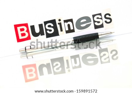 Business still life with ball pen - stock photo