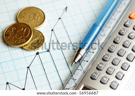Business still-life with coins, pen and calculator - stock photo