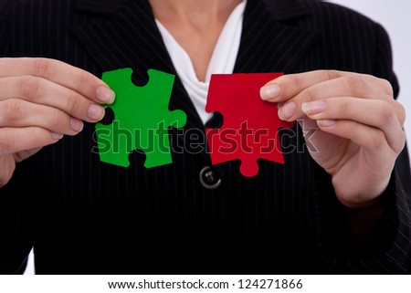 business strategy concept with puzzle pieces and a businesswoman